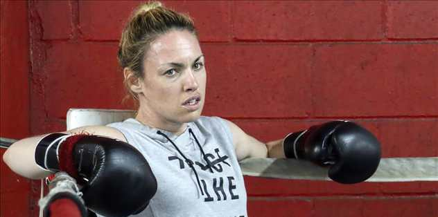 Single mom retires boxing for daughter