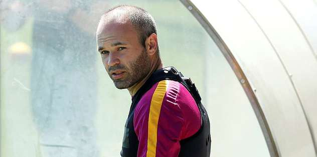 Deep-lying Iniesta aims for more glory